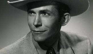 """In this undated photo released by the Country Music Hall of Fame, country music artist Hank Williams is shown. Previously unreleased recordings of country music legend Hank Williams performing songs on a 1950 radio show will be released next month for download and on vinyl. """"The Garden Spot Programs, 1950"""" features 24 songs and jingles from a taped show that aired on early country radio stations, sponsored by a Texas plant nursery. Most of the tapes were lost, but one station, KSIB-AM in Creston, Iowa, saved its copies. The recordings were transferred, restored and mastered for release on May 20 by Omnivore Records. (AP Photo/Country Music Hall of Fame)"""
