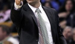 Boston Celtics head coach Brad Stevens gestures from the sideline during the second half of an NBA basketball game against the Washington Wizards in Boston, Wednesday, April 16, 2014. The Wizards won 118-102. (AP Photo/Elise Amendola)