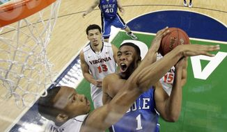 FILE - In this March 16, 2014 file photo, Duke's Jabari Parker (1) tries to shoot over Virginia's Darion Atkins during the first half of an NCAA college basketball game in the championship of the Atlantic Coast Conference tournament in Greensboro, N.C. Parker says he plans to meet with Duke coach Mike Krzyzewski when he returns to Durham, N.C., on Tuesday, April 15, 2014, and he will decide Wednesday whether to declare for the NBA draft or return to college for his sophomore year.  (AP Photo/Bob Leverone, File)