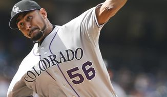 Colorado Rockies starting pitcher Franklin Morales works against the San Diego Padres during the first inning of a baseball game Thursday, April 17, 2014, in San Diego. (AP Photo/Lenny Ignelzi)