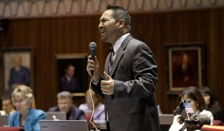 Rep. Martin Quezada, D-Phoenix, speaks with emotion as he debates an amendment to House Bill 2291, an expansion for Arizona's school-voucher program, before members vote on the measure at the Arizona Capitol on Thursday, April 17, 2014, in Phoenix.  Key Republicans banded with Democrats to vote down House Bill 2291, which would have made another 100,000 to 120,000 low-income students eligible for the Arizona Empowerment Scholarship Accounts program. (AP Photo/Ross D. Franklin)