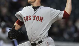 Boston Red Sox starter Jon Lester delivers a pitch during the first inning of a baseball game against the Chicago White Sox in Chicago, Thursday, April 17, 2014. (AP Photo/Paul Beaty)