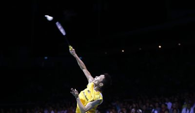 10ThingstoSeeSports - Lee Chong Wei of Malaysia returns a shot to Simon Santoso of Indonesia during their men's singles final match at the Singapore Open Badminton championship on Sunday, April 13, 2014, in Singapore. (AP Photo/Wong Maye-E, File)