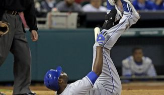 Kansas City Royals' Lorenzo Cain falls onto his back after fouling a ball off his foot against the Houston Astros in the fourth inning of a baseball game on Wednesday, April 16, 2014, in Houston. (AP Photo/Pat Sullivan)