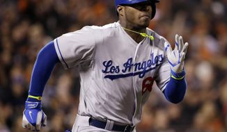 Los Angeles Dodgers' Yasiel Puig runs to first base as he grounds out during the eighth inning of a baseball game on Wednesday, April 16, 2014, in San Francisco. San Francisco won 2-1. (AP Photo/Marcio Jose Sanchez)