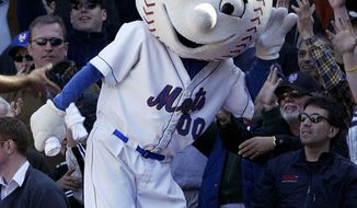 ** FILE ** New York Mets mascot Mr. Met reacts with the crowd during the Mets home opener against the Houston Astros at Shea Stadium in New York, in this April 11, 2005, file photo. (AP Photo/Gregory Bull/FILE)