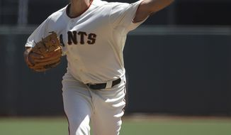 San Francisco Giants pitcher Madison Bumgarner throws against the Los Angeles Dodgers during the first inning of a baseball game in San Francisco, Thursday, April 17, 2014. (AP Photo/Jeff Chiu)