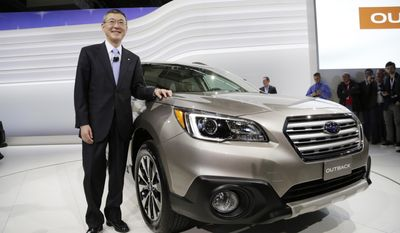 Yasuyuki Yoshinaga, Chairman, President and CEO of Fuji Heavy Industries, stands with the 2015 Subaru Outback at the New York International Auto Show, Thursday, April 17, 2014 in New York. (AP Photo/Mark Lennihan)