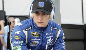 FILE - In this April 11, 2014 file photo, Cole Whitt waits before qualifying for a NASCAR Sprint Cup series auto race at Darlington Speedway in Darlington, S.C. Swan Racing's future is on the rocks and the two-car team is reviewing its ability to compete in NASCAR. Whitt drives the No. 26 Toyota Camry and Parker Kligerman drives the No. 30 Toyota Camry for Swan in the Sprint Cup series. Swan Racing is owned by Brandon Davis, the CEO of independent oil and gas company Swan Energy.   (AP Photo/Mike McCarn, File)