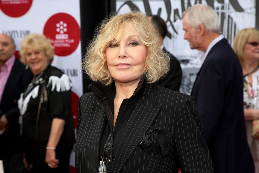 "FILE - In this Thursday, April 10, 2014 file photo, Kim Novak arrives at the 2014 TCM Classic Film Festival's Opening Night Gala at TCL Chinese Theatre in Los Angeles. Novak says that cruel jabs about how she looked during the Oscar March 2 ceremony amounted to bullying that left her at first crushed and then determined to speak out in protest. Turner Classic Movies host Robert Osborne agreed to discuss it during an interview with Novak that preceded a festival screening last Saturday, April 12, 2014, of her film ""Bell, Book and Candle."" (Photo by Annie I. Bang /Invision/AP, file)"