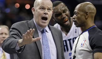 Charlotte Bobcats coach Steve Clifford argues a call with a referee during the second half of an NBA basketball game against the Chicago Bulls in Charlotte, N.C., Wednesday, April 16, 2014. The Bobcats won 91-86 in overtime. (AP Photo/Chuck Burton)
