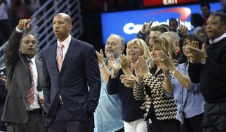 New Orleans Pelicans head coach Monty Williams, second from left, reacts as the clock expires to end their season in the second half of an NBA basketball game against the Houston Rockets in New Orleans, Wednesday, April 16, 2014. The Pelicans won 105-100. (AP Photo/Gerald Herbert)