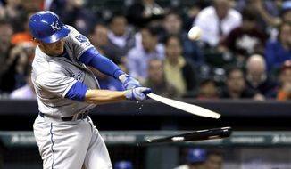 Kansas City Royals' Danny Valencia breaks his bat as he flies out to Houston Astros shortstop Marwin Gonzalez in the sixth inning of a baseball game Wednesday, April 16, 2014, in Houston. (AP Photo/Pat Sullivan)