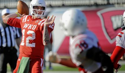 In this April 12, 2014 photo, Western Kentucky quarterback Brandon Doughty prepares to throw a pass during practice at Houchens-Smith Stadium in Bowling Green, Ky. (AP Photo/Daily News, Alex Slitz)