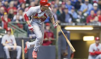 St. Louis Cardinals' Joe Kelly tries to out run a bunt against the Milwaukee Brewers during the fifth inning of a baseball game Wednesday, April 16, 2014, in Milwaukee. Kelly was out on the play. (AP Photo/Tom Lynn)