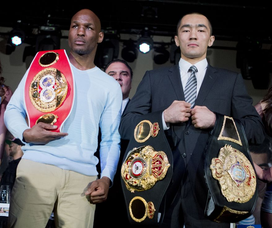 IBF light heavyweight boxing champion Bernard Hopkins, left, and WBA and IBA light heavyweight boxing champion Beibut Shumenov, right, of Kazakhstan, pose with their championship belts during a news conference in Washington, Thursday, April 17, 2014, about their 175-pound unification fight to be held at the DC Armory in Washington on April 19. (AP Photo/Manuel Balce Ceneta)