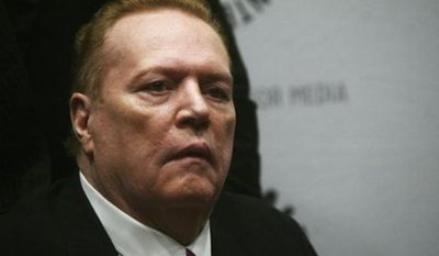FILE - In this Oct. 26, 2007 file photo, Hustler magazine founder Larry Flynt arrives at the premiere of the documentary 'Larry Flynt: The Right to be Left Alone' at The Paley Center for Media in New York. An AIDS activist group filed a workplace safety complaint against Larry Flynt on Thursday, Aug. 26, 2010, accusing the porn king of creating an unsafe environment for his stable of sex stars by not requiring they use condoms. (AP Photo/Gary He, File)
