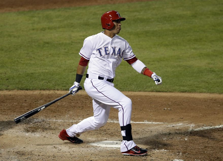 Texas Rangers' Leonys Martin follows through on a solo home run swing off a pitch from Chicago White Sox's Felipe Paulino in the fourth inning of a baseball game, Friday, April 18, 2014, in Arlington, Texas. (AP Photo/Tony Gutierrez)