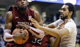 ADVANCE FOR WEEKEND EDITIONS, APRIL 20-21- FILE - In this Jan. 10, 2013, file photo, Temple forward Anthony Lee, left, pulls a rebound away from Xavier forward Jeff Robinson in the first half of an NCAA college basketball game in Cincinnati. Division I coaches are realizing that they can win both now and later with transfers, who are suddenly viewed more like shiny new toys than damaged goods. A recent surge in player movement has turned the once-sleepy late signing period, which starts on Wednesday and runs through May 21, into a month-long free agent frenzy that's transformed the game. (AP Photo/Al Behrman, File)