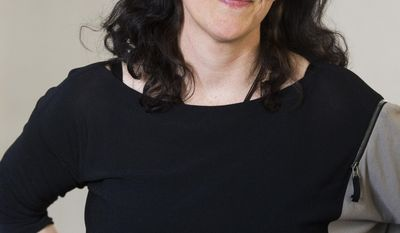 "This April 16, 2014 photo shows Pulitzer Prize and Polk Award winner Laura Poitras in New York to promote her documentary film ""1971,"" premiering Friday at the Tribeca Film Festival. (Photo by Charles Sykes/Invision/AP)"