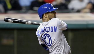 Toronto Blue Jays' Edwin Encarnacion watches his RBI single off Cleveland Indians relief pitcher Cody Allen in the seventh inning of a baseball game, Friday, April 18, 2014, in Cleveland. Melky Cabrera scored. (AP Photo/Tony Dejak)