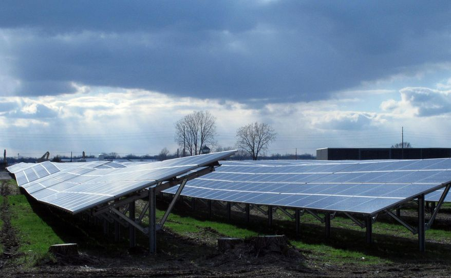 ** FILE ** Sunlight streams onto the Maywood Solar Farm in Indianapolis on Tuesday, April 15, 2014. The 8-megawatt solar farm completed last month is the nation's largest solar farm on a federal Superfund site. (AP Photo/Rick Callahan)