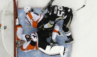 Pittsburgh Penguins' Jayson Megna (59) checks Philadelphia Flyers' Andrew MacDonald (47) into Flyers goalie Steve Mason (35) in the second period of an NHL hockey game in Pittsburgh, Saturday, April 12, 2014. Megna was penalized for goaltender interference. Mason was shaken up on the play, and did not return for the third period. The Flyers won 4-3 in overtime. (AP Photo/Gene J. Puskar)