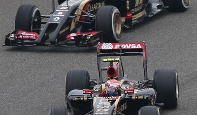 Lotus driver Romain Grosjean of France, top, and his teammate driver Pastor Maldonado of Venezuela, bottom, drive during the practice session for Sunday's Chinese Formula One Grand Prix at Shanghai International Circuit in Shanghai, Friday, April 18, 2014. (AP Photo/Eugene Hoshiko)