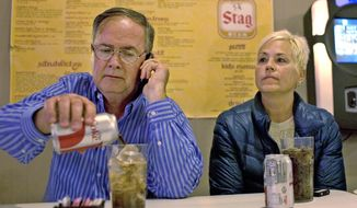 In this March 19, 2014 photo, former Illinois Department of Natural Resources official and unsuccessful Democratic candidate for the 115th Illinois house district, Tony Mayville, and his wife, Charlotte, waiting for results election night at Scheller Playhouse in Scheller, Ill. Illinois Department of Natural Resources spokesman Chris Young confirmed Friday, April 18, that Tony Mayville was dismissed this week from his position as supervisor of mine safety enforcement with the DNR's Office and Mines and Minerals. (AP Photo/The Southern Illinoisan, Steve Matzker)