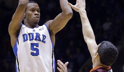 """FILE - In this Feb. 25, 2014 file photo, Duke's Rodney Hood (5) shoots over Virginia Tech's Devin Wilson during the first half of an NCAA college basketball game in Durham, N.C. Hood is entering the NBA draft. Hood said in a statement Friday, April 18, 2014, that playing for Mike Krzyzewski """"helped me grow and develop as a player and a person"""" to prepare him for the NBA.  (AP Photo/Gerry Broome, File)"""