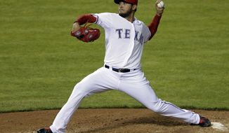 Texas Rangers' Martin Perez delivers to the Chicago White Sox in the fourth inning of a baseball game, Friday, April 18, 2014, in Arlington, Texas. (AP Photo/Tony Gutierrez)