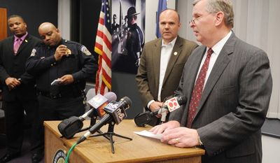 Indianapolis Mayor  Greg Ballard speaks to the media following what is believed to be a murder suicide involving Indianapolis  Metro Police department personnel Thursday April 17, 2014.  (AP Photo/The Indianapolis Star, Rob Goebel)