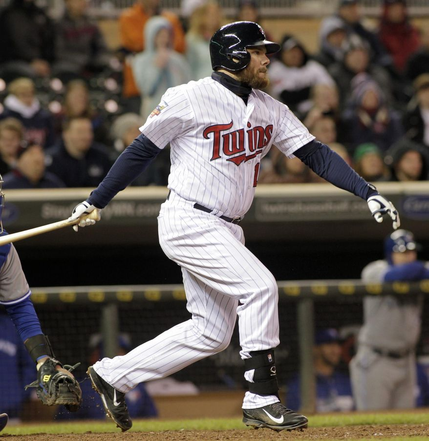 Minnesota Twins' Jason Kubel watches his two-run single during the eighth inning of the second game of a baseball doubleheader against the Toronto Blue Jays, Thursday, April 17, 2014, in Minneapolis. Minnesota won 9-5. AP Photo/Paul Battaglia)