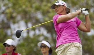 Angela Stanford watches her drive off the second tee in the third round of the LPGA LOTTE Championship golf tournament at Ko Olina Golf Club on Friday, April 18, 2014, in Kapolei, Hawaii. (AP Photo/Eugene Tanner)