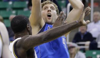 ADVANCE FOR WEEKEND EDITIONS, APRIL 20-21 - FILE - In this April 8, 2014 file photo, Dallas Mavericks' Dirk Nowitzki (41) shoots as Utah Jazz's Marvin Williams, left, defends in the first quarter during an NBA basketball game in Salt Lake City. While it will take a major upset for the Mavericks to get past top-seeded San Antonio in the first round, Nowitzki looks like he could be around for two or three more runs at a second title. (AP Photo/Rick Bowmer, FIle)
