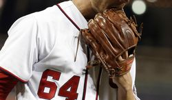 Washington Nationals relief pitcher Blake Treinen comes off the field during the seventh inning of a baseball game against the St. Louis Cardinals at Nationals Park on Thursday, April 17, 2014, in Washington. The Cardinals won 8-0. (AP Photo/Alex Brandon)