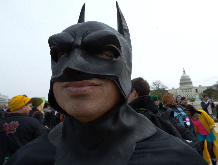 Phil Custodio, 44 of Flint, MI dressed as Batman was one of 237 people that joined Awesome Con D.C. and the Museum of Science Fiction attempt to break a world record for the largest gathering of people dressed as comic book characters at the U.S. Capitol Reflecting Pool on Friday, April 18. The current record holder is China; which stands at 1,530 people, set on April 19, 2011 at the opening ceremony of the International Animation CCJOY LAND. Awesome Con D.C. and the Museum of Science Fiction didn't come close with only 237 people showing up. (Khalid Naji-Allah/ Special to The Washington Times)