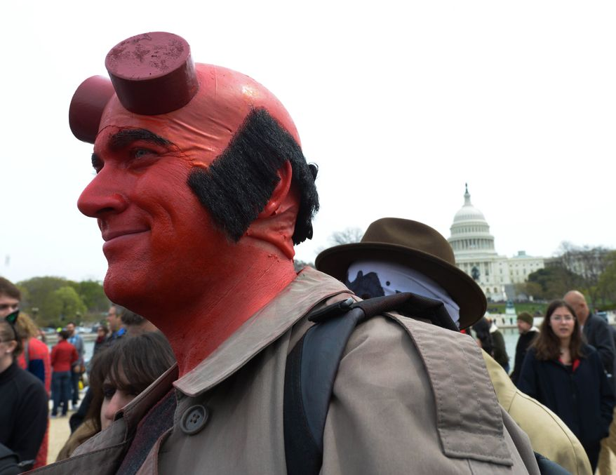 Awesome Con D.C. and the Museum of Science Fiction attempted to break a world record for the largest gathering of people dressed as comic book characters at the U.S. Capitol Reflecting Pool on Friday, April 18. The current record holder is China; which stands at 1,530 people, set on April 19, 2011 at the opening ceremony of the International Animation CCJOY LAND. Awesome Con D.C. and the Museum of Science Fiction didn't come close with only 237 people showing up. (Khalid Naji-Allah/ Special to The Washington Times)