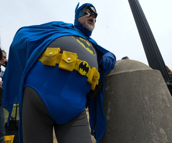 Holy Smokes Batman! Rich Willett, 58 of Sterling, VA, joined forces with Awesome Con D.C. and the Museum of Science Fiction to attempt to break a world record for the largest gathering of people dressed as comic book characters at the U.S. Capitol Reflecting Pool on Friday, April 18. The current record holder is China; which stands at 1,530 people, set on April 19, 2011 at the opening ceremony of the International Animation CCJOY LAND. Awesome Con D.C. and the Museum of Science Fiction didn't come close with only 237 people showing up. (Khalid Naji-Allah/ Special to The Washington Times)