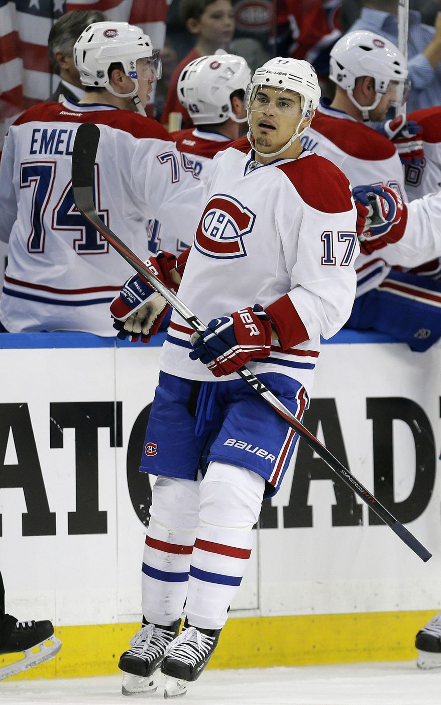 Montreal Canadiens left wing Rene Bourque (17) celebrates with teammates after scoring against the Tampa Bay Lightning during the second period of Game 2 of a first-round NHL hockey playoff series on Friday, April 18, 2014, in Tampa, Fla. (AP Photo/Chris O'Meara)