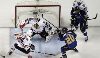 St. Louis Blues' Alexander Steen (20) scores the game-winning goal past Chicago Blackhawks goalie Corey Crawford and Niklas Hjalmarsson (4) as Blues' Steve Ott (29) and Blackhawks' Johnny Oduya (27), of Sweden, watch during the third overtime in Game 1 of a first-round NHL hockey Stanley Cup playoff series Thursday, April 17, 2014, in St. Louis. The Blues won 4-3 in triple overtime. (AP Photo/Jeff Roberson)