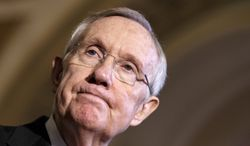 ** FILE ** This April 8, 2014, file photo shows Senate Majority Leader Harry Reid of Nevada pausing during a news conference on Capitol Hill in Washington. (AP Photo/J. Scott Applewhite, File)