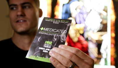 """Pastor Justice Coleman, founder of Freedom Church poses for a picture with a flyer from his coming service Thursday, April 17, 2014 in Highland Park, Calif. Coleman  is using medical marijuana imagery and catchy word play to attract new worshippers to an Easter sermon series called """"Medicated,"""" about seeking fulfillment through God, not drugs. (AP Photo/Chris Carlson)"""