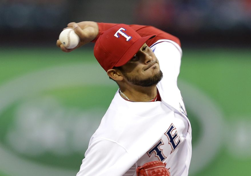 Texas Rangers pitcher Martin Perez works against the Chicago White Sox in the second inning of a baseball game, Friday, April 18, 2014, in Arlington, Texas. (AP Photo/Tony Gutierrez)