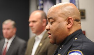Police Chief Richard Hite speaks to the media following what is believed to be a murder suicide involving Indianapolis  Metro Police department personnel Thursday April 17, 2014.  (AP Photo/The Indianapolis Star, Rob Goebel)