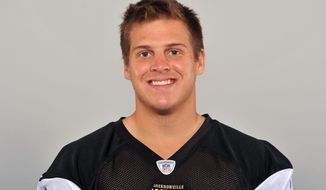 """FILE - This 2013 file photo shows Carson Tinker of the Jacksonville Jaguars NFL football team. Tinker is no longer that no-name guy who delivers the ball on punts and kicks. The Jaguars longsnapper shed that anonymity nearly three years ago when an EF-4 tornado ripped through Tuscaloosa, Ala., leaving him physically and emotionally scarred and killing his girlfriend Ashley Harrison. As an Alabama football player, Tinker became one of the faces of a vicious storm that left dozens dead in Tuscaloosa alone. He has since shared his experience with youth groups and churches and written a book _ """"A Season To Remember: Faith in the Midst of the Storm.""""(AP Photo/File)"""