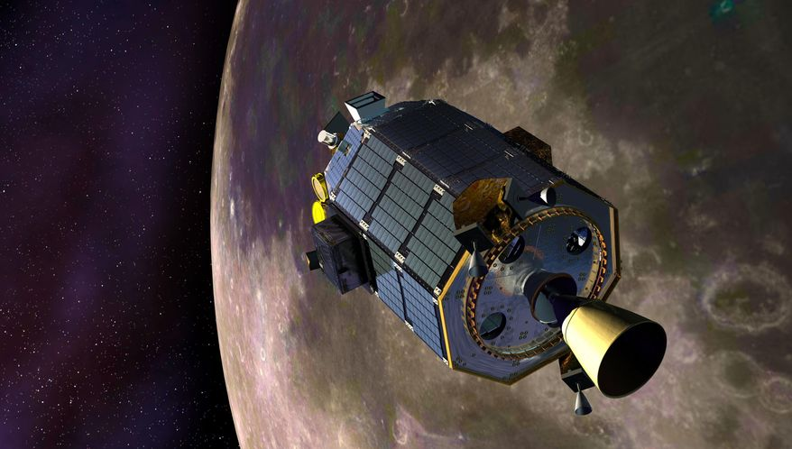 In this artist's concept provided by NASA, the Lunar Atmosphere and Dust Environment Explorer (LADEE) spacecraft orbits the moon. Flight controllers on Friday, April 18, 2014 confirmed that the orbiting spacecraft crashed into the back side of the moon as planned, just three days after surviving a full lunar eclipse, something it was never designed to do. (AP Photo/NASA, Dana Berry)