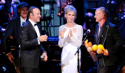 Actor Kevin Spacey, Trudie Styler and Sting perform together during the finale at the 25th Anniversary Rainforest Fund benefit concert at Carnegie Hall on Thursday, April 17, 2014 in New York. (Photo by Evan Agostini/Invision/AP)