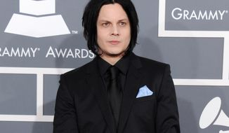"FILE - This Feb. 10, 2013 file photo shows musician Jack White at the 55th annual Grammy Awards in Los Angeles. White is going direct to vinyl with the first live performance of a song off his upcoming album on Record Store Day. Fans will get to see him perform the title track from ""Lazaretto"" on Saturday morning, which will be recorded and pressed into a limited edition vinyl record that afternoon. (Photo by Jordan Strauss/Invision/AP, File)"