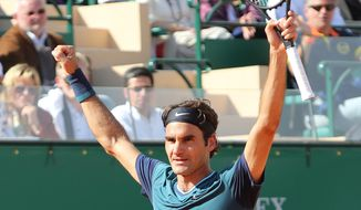 Roger Federer of Switzerland celebrates after defeating Novak Djokovic of Serbia, in their semifinal match of the Monte Carlo Tennis Masters tournament,  in Monaco, Saturday, April, 19, 2014. Federer won 7-6, 6-2.  (AP Photo/Claude Paris)